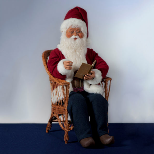 Santa Claus sitting in a chair, reading a book with synchronised mouth movements.