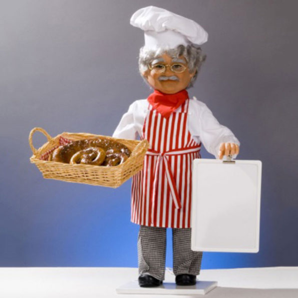 Baker with basket and signboard.